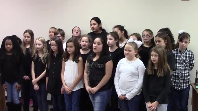 CIS students singing at the BISD Board Meeting