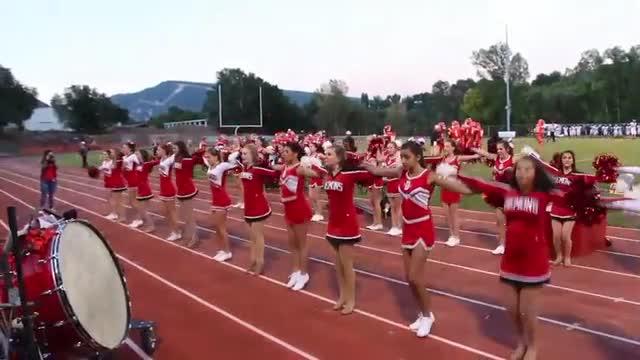 Cheerleaders cheering at a Durango High School football game.