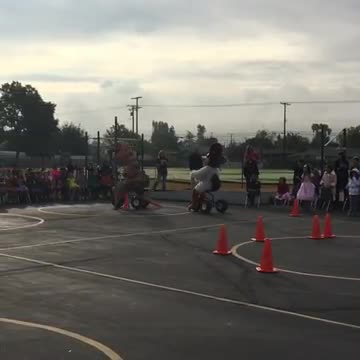 Ramona Roadrunner vs. T-Rex during the Red Ribbon Week Tricycle Race - Cheering and Music Playing in the background throughout