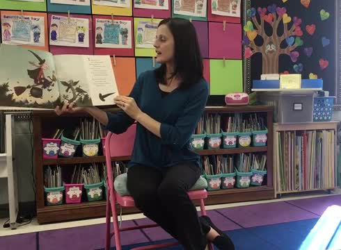Teacher reading book to students