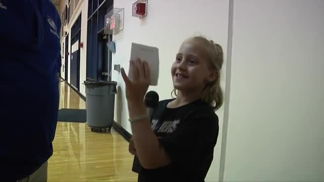 Student interviewing volleyball coach