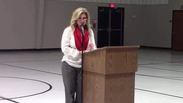 Mrs. Limmer reads a poem at the Kindergarten Awards program.