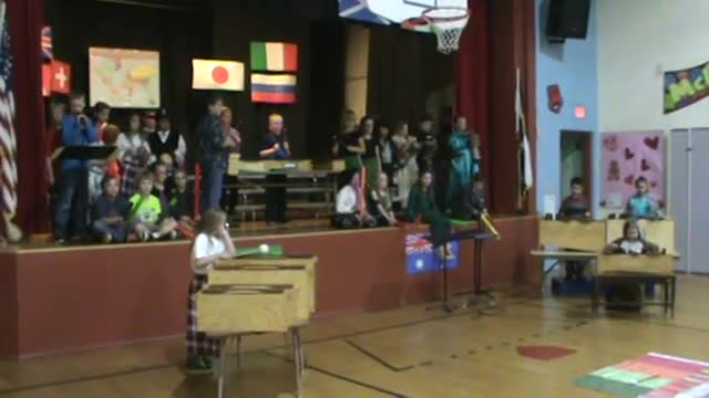 Students play instruments during Cultural concert.