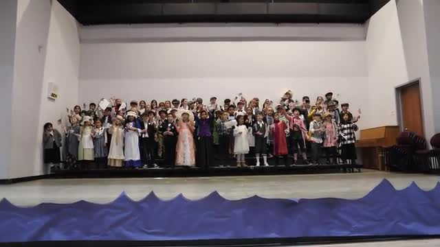 Here is second grade performing another patriotic song at Ellis Island Day.