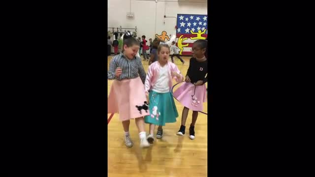 Girls dancing at the LSM Sock Hop
