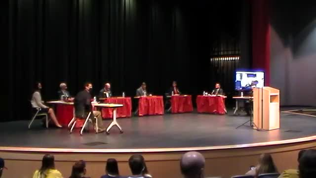 This is a video of the board of education meeting held July 28. The screen shows board members sitting on a stage at the Freshman School.