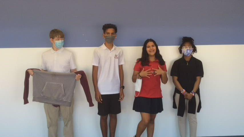 Students explaining uniform policy