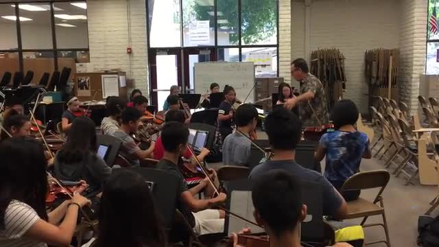 Orchestra performing song during practice