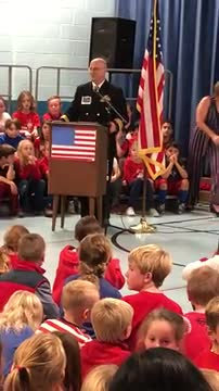 Sean Carroll addresses the staff and students about honor, teamwork, and respect during the Veterans Day Program on Nov. 8th.