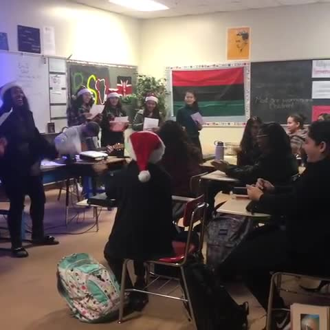 Student council caroling in classrooms in 2018