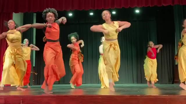 students dancing to African music on stage