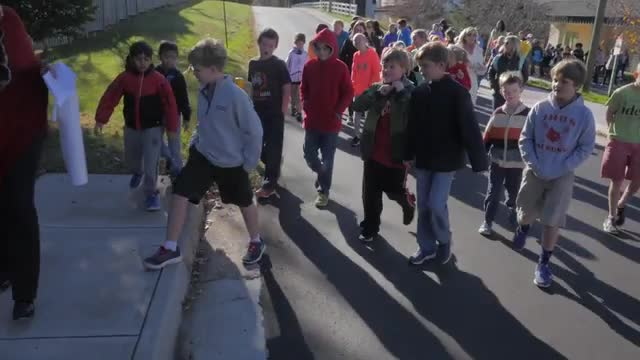 James River Day School students, faculty, staff, and parents walk to Fire Station #5 each fall to say