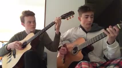 two advanced guitar students play a blues song