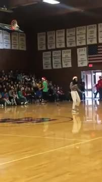 Video of student in gym rapping to crowd