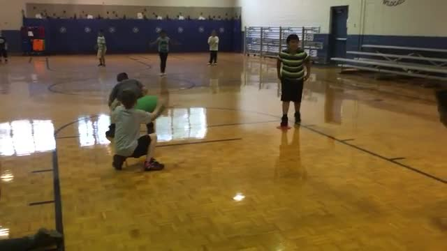 Mrs. Grindstaff's class practicing field goal kicking, catching, holding and snapping the Super Football
