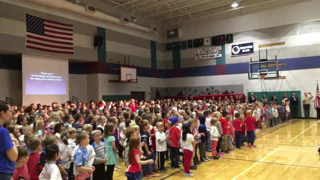 Star Spangled Banner being sung by Brentwood students and staff.