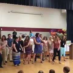 Western staff attempts to floss (dance) for students at the final award assembly.