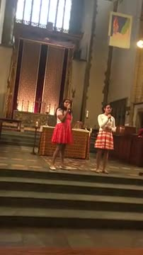 NYI students Aolani and Isabelle singing at the Church of the Intercession