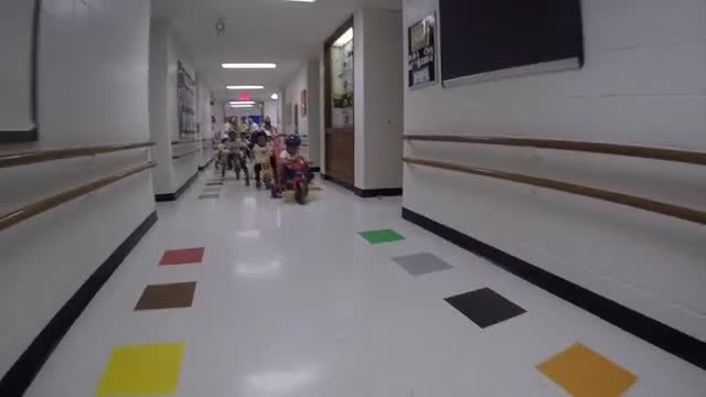 Readiness Children doing a lap around the hallways in support of the Trike-a-thon for St. Jude's Hospital