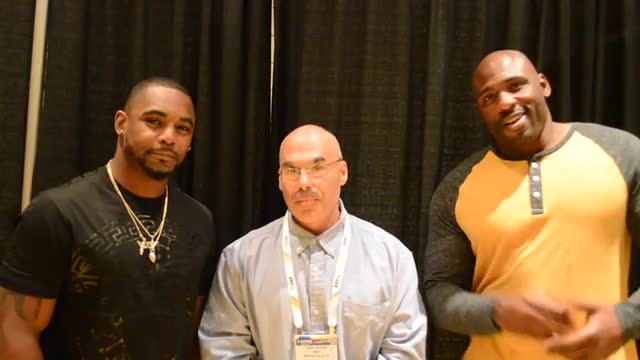 Van Cleve teacher Anthony Apuzzi with New York Giants Brandon Jacobs and Ahmad Bradshaw talking about education