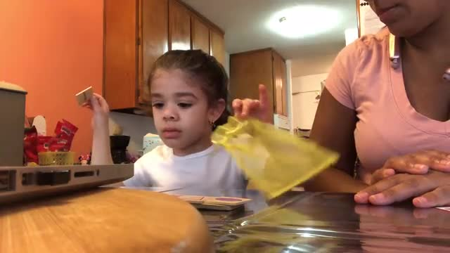 Video of a parent working with her child.