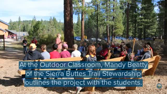 Students build a trail while learning about earth science
