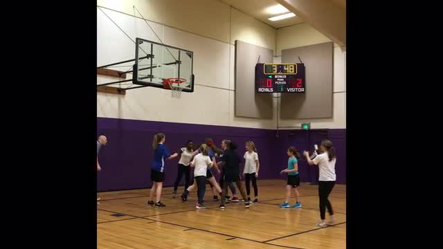 Short clip of girls March Madness team playing basketball