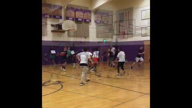 Short clip depicting junior high boys playing basketball