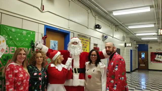 Pictures of holiday celebration in school. Pajama day santa visits, students smiling and having fun.