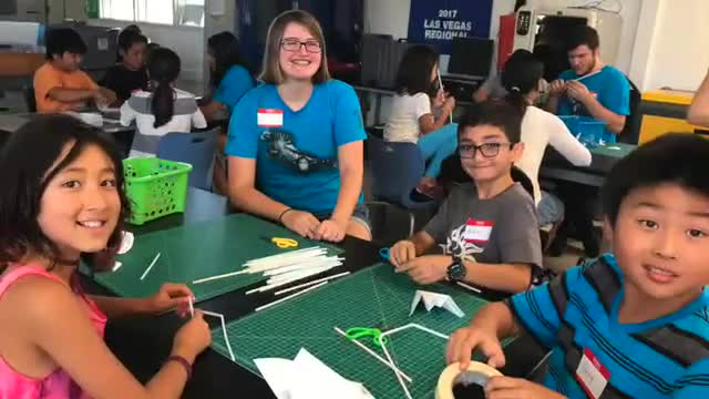 Peninsula High School students work with Soleado Elementary students at STEM camp.
