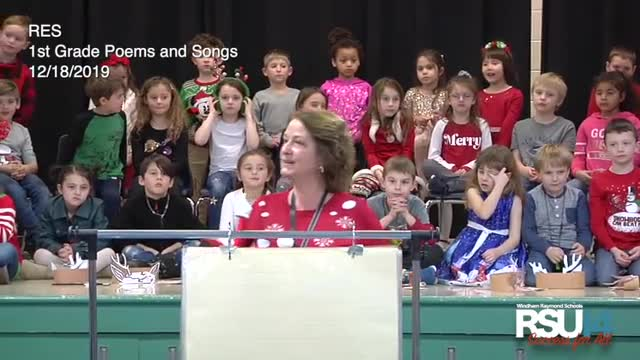 First grade students from Raymond Elementary School present poems and songs
