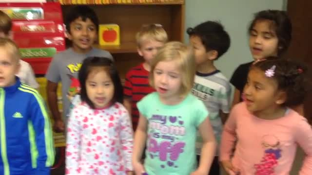 Preschool students learning Spanish and singing.