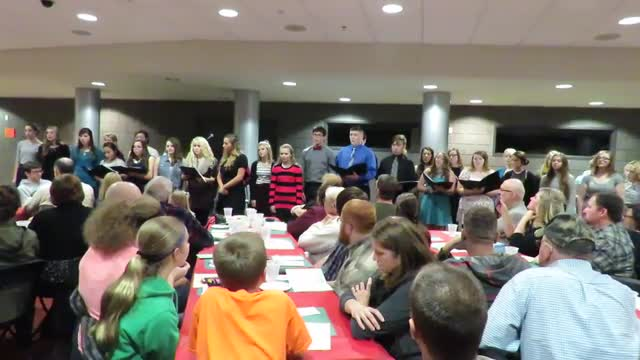 The TKHS Honors Choir performs some holiday favorites at the annual Dessert Theater.