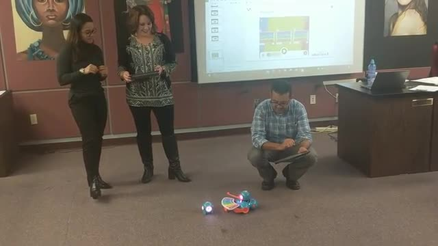 Teachers working on programing the dash and dot video 4