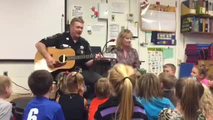 We had the privilege of having a mini concert performed by our principal, Mrs. Call and PRO Officer Rocky Hebb. The students had a blast listening and singing along with them!