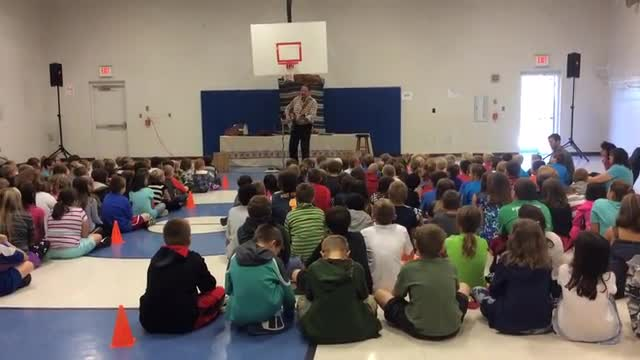 Mr. Suder preforming for the students at French Creek Elementary