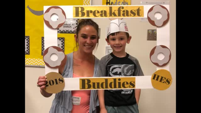 Video of Love ones and students enjoying a breakfast of donuts together.