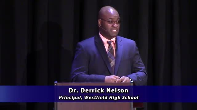 Dr. Derrick Nelson at a podium, talking about self-management.