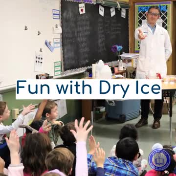 Photo of Tamaques parent teaching students about dry ice and steam during STEAM Day.
