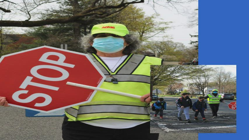 Photo of crossing guard and people crossing street